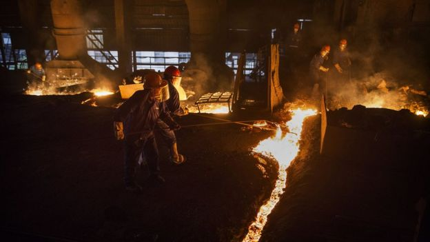Chinese steelworkers at a smelter