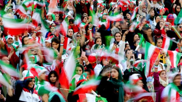 Iranian women cheer during the World Cup Qatar 2022 Group C qualification football match between Iran and Cambodia at the Azadi stadium in the capital Tehran on 10 October, 2019.