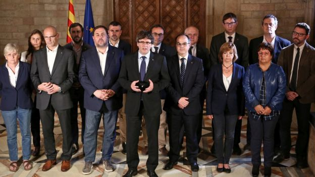 Catalan Regional President Carles Puigdemont (C) is flanked by members of his government as he makes a statement. 1 Oct 2017