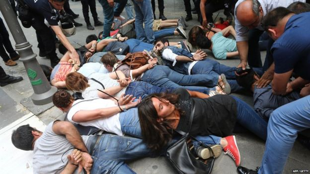Demonstrators are detained by Turkish police officers in Ankara