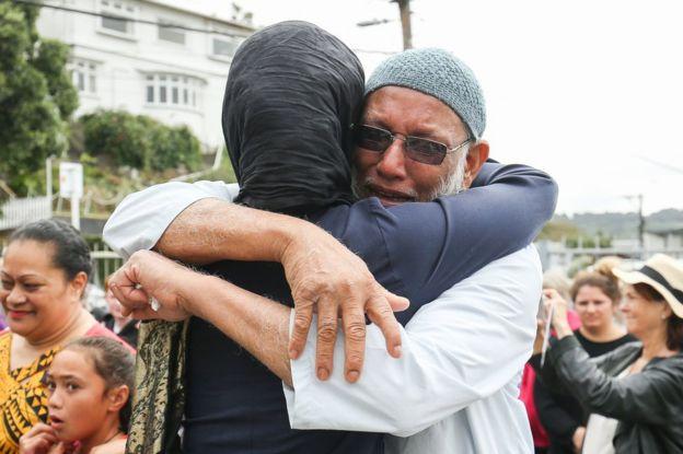 Jacinda Ardern hugs man