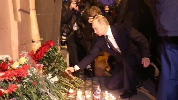 Russian President Vladimir Putin places flowers in memory of victims of the blast in the Saint Petersburg metro outside Technological Institute station on April 3, 2017