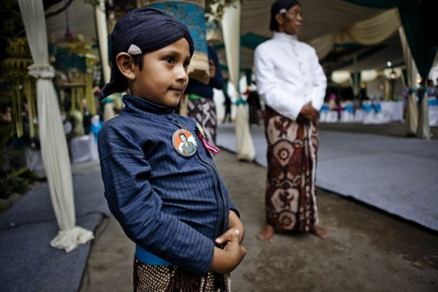 Yogya boy wearing campaign image of the Queens bid for the senate.