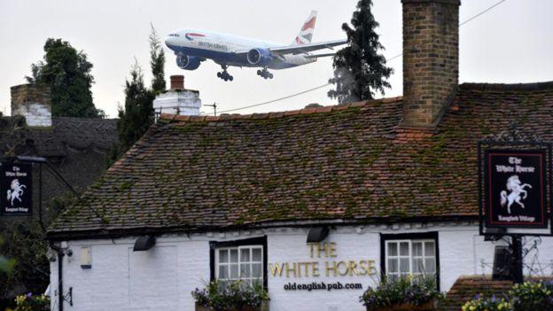 plane over pub