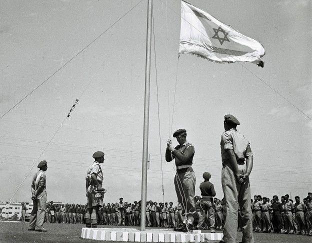 Hoisting the flag of Israel.