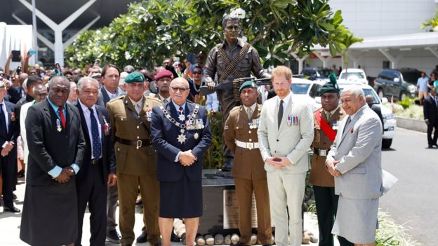 "Britain""s Prince Harry and Fiji""s President Jioji Konrote pose in front of a new statue commemorating Sergeant Talaiasi Labalaba"