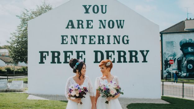 Danielle Doherty and Emma Bradley standing outside Free Derry corner