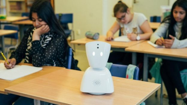 AV1 robot on a classroom desk