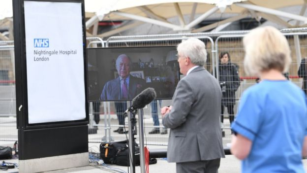 The Prince of Wales, known as the Duke of Rothesay while in Scotland, sends a video message to guests at the opening of the NHS Nightingale Hospital at the ExCel centre in London