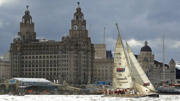 """The Garmin team wins a """"sprint finish"""" to conclude the Clipper 2017-2018 Round the World Yacht Race outside the Royal Albert Dock in Liverpool"""