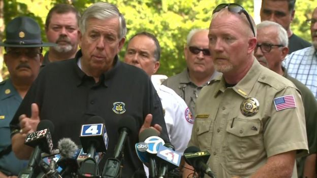 Missouri governor Mike Parson and Stone County Sheriff Doug Rader speaking with reporters on Friday