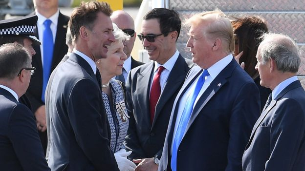 Foreign Secretary Jeremy Hunt greets US President Donald Trump as he arrives at Stansted Airport