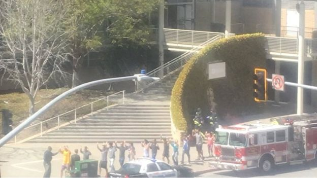 People gather outside a building following a shooting at the headquarters of YouTube, in San Bruno, California, U.S., April 3, 2018 in this picture obtained from social media.
