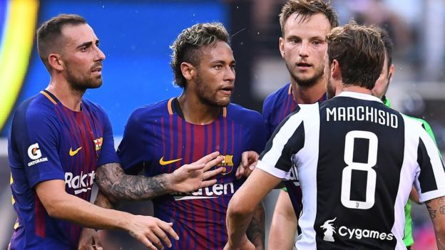 Barcelona and Juventus football players confront each other