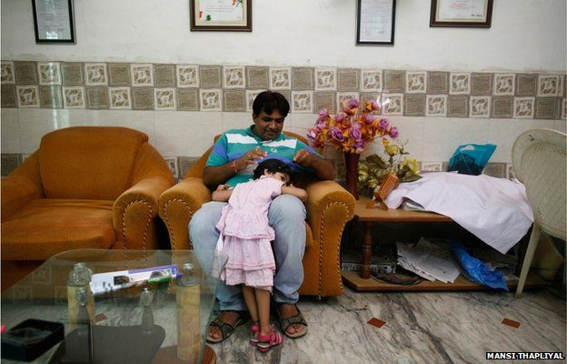 Sunil Jaglan, village chief with his daughter