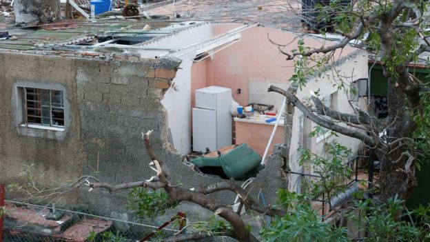 A home with a damaged roof in Havana