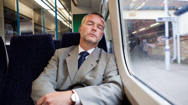 Man sleeping in train