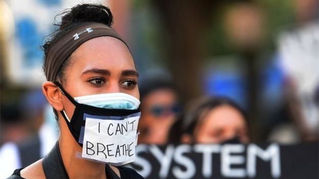 """Protester in mask saying """"I can't breathe"""" in Los Angeles"""