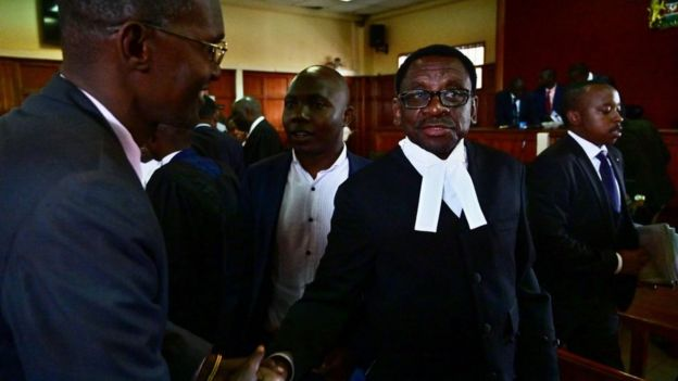 Lead counsel in the defence team of embattled Deputy Chief Justice Philomena Mwilu, James Orengo (R), reacts on May 31, 2019, in Nairobi, following a determination by the court not to prosecute Mwilu over corruption charges