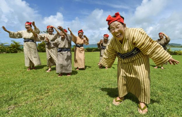 Elderly women dance on the island of Kohama, in Okinawa, Japan, on June 22, 2015.