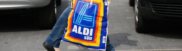 shopper carries aldi carrier bag
