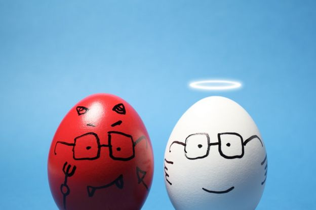"Close-up of ""evil"" and ""angel"" eggs, against blue background."