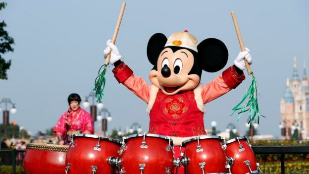 Mickey Mouse plays drums