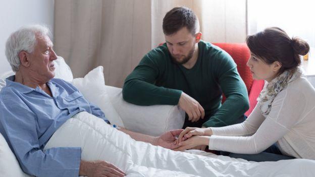 Paciente junto à família