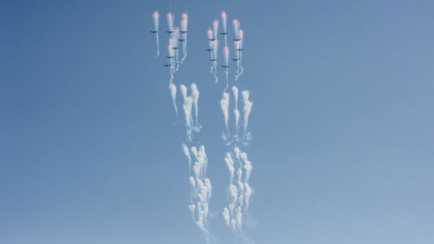 Aircrafts perform a fly-by during a mass rally