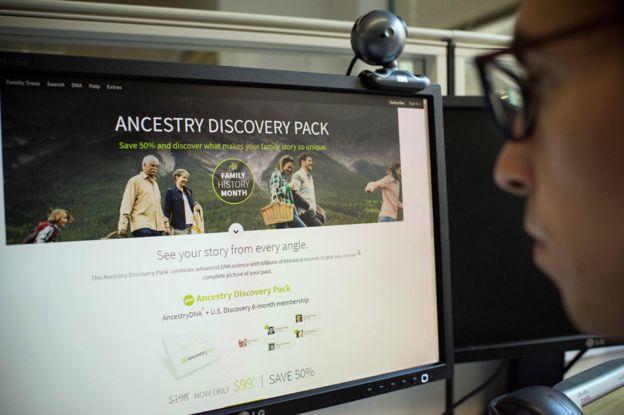 Man looking at DNA testing kit deal online