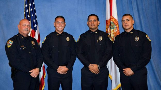 Officer Raja (second from right) was fired shortly after the shooting