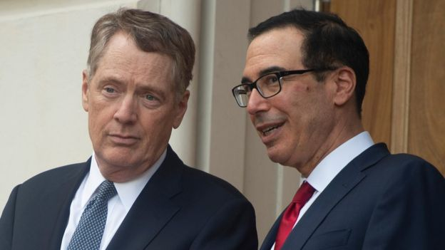 US Trade Representative Robert Lighthizer (L) speaks with Steven Mnuchin, United States Secretary of the Treasury, as they wait for Chinese Vice Premier Liu He to arrive at the the Office of the United States Trade Representative for tariff negotiations in Washington DC on May 9, 2019