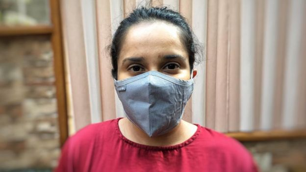 Activist and aid worker Srabanti Huda wearing a face mask