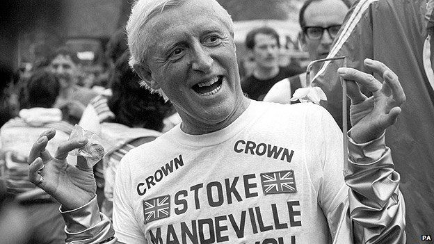 Jimmy Savile wearing a Stoke Mandeville Hospital t-shirt after running a marathon in aid of the hospital in 1981