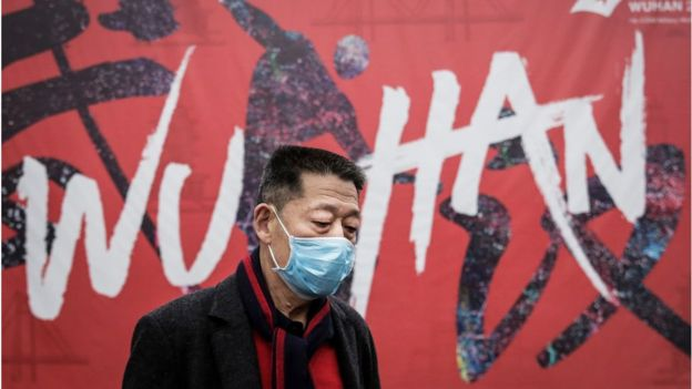 A man wears a mask while walking in the street on January 22, 2020 in Wuhan, Hubei province, China