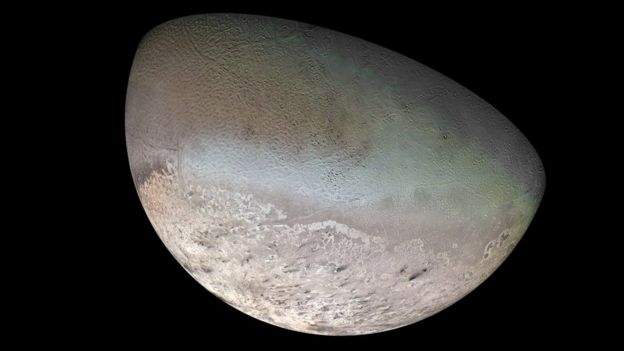 Image of a moon with a mottled surface like a cantaloupe melon