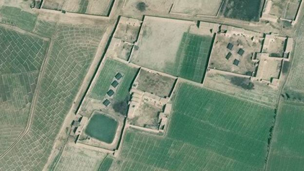 A zoomed-in satellite image shows the banks of solar panels in a farm in Helmand