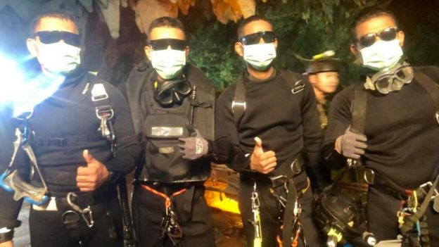 The last of the rescuers - one doctor and three divers, all part of the Thai Navy Seals - give thumbs up after leaving the cave system