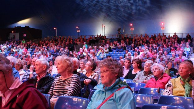 """""""Tawelwch plîs, pob chware teg!"""" // The audience transfixed during a performance in the pavilion"""