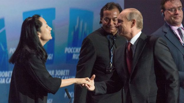 "Russia""s President Vladimir Putin (R) greets Meng Wanzhou, of the Chinese technology giant Huawei, at the VTB Capital Investment Forum ""Russia Calling!"" in Moscow in October 2014"