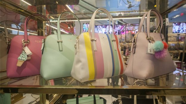 Spring coloured handbags on display at the Kate Spade boutique within Macy's in New York on Sunday, March 20, 2016