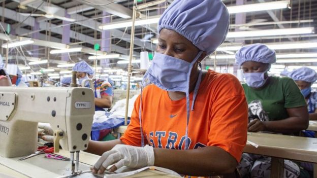 Woman sewing a face mask in a factory