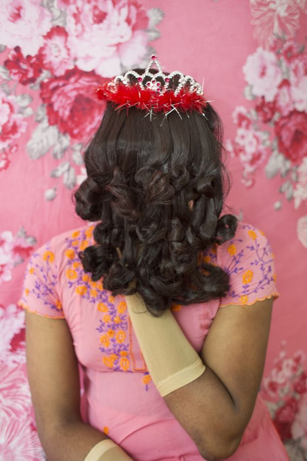 Bangladeshi woman with face covered by a wig