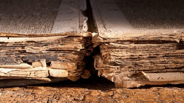 Tattered pages of a 300 years old book