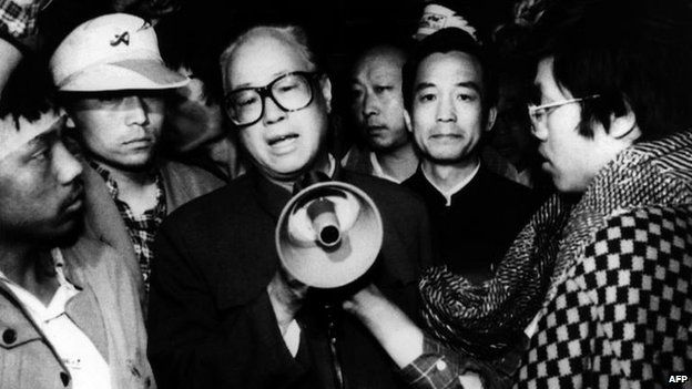 In this 19 May 1989 file photo, Communist Party General Secretary Zhao Ziyang, centre with loud hailer, speaks with fasting university students in Beijing's Tiananmen Square, the last time he was seen in public
