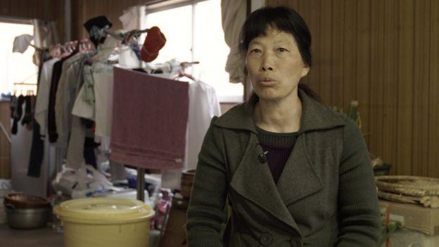 Zhang, una costurera china.
