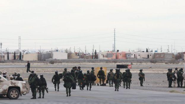 Mexican soldiers on guard at Ciudad Juarez airport, where El Chapo Guzman's plane took off