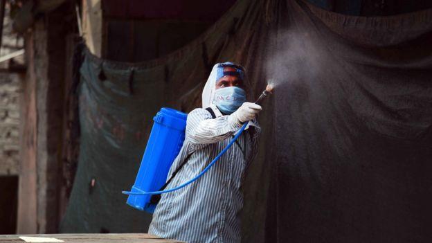 A man disinfecting a neighbourhood