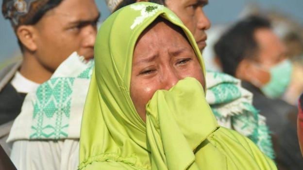 A woman cries following an earthquake and a tsunami in Palu, Sulawesi island, 29 September 2018