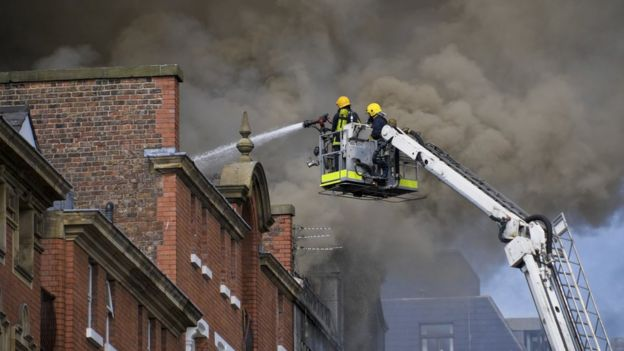 Firefighters tackle a building fire